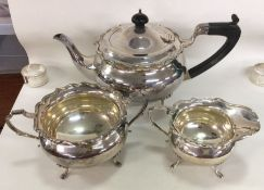 A heavy silver three piece tea service. Birmingham