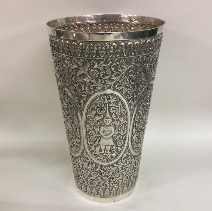 A large chased Indian silver tapering vase decorat - Image 2 of 2