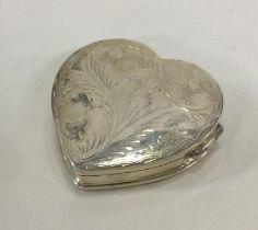 A large silver heart shaped box. 925 standard. App