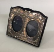 A small silver double picture frame. London. By KF