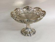 An Edwardian silver bonbon dish of shaped form. Bi