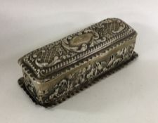 An embossed silver dressing table box decorated wi