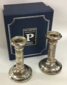 A pair of cased silver candlesticks. London. By WM