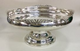 A heavy Edwardian silver fruit dish with stylised