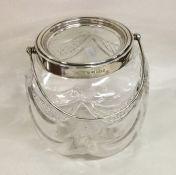A silver mounted cut glass biscuit barrel of circu