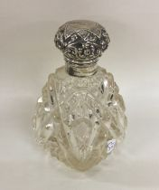 A hobnail cut silver topped scent bottle with embo