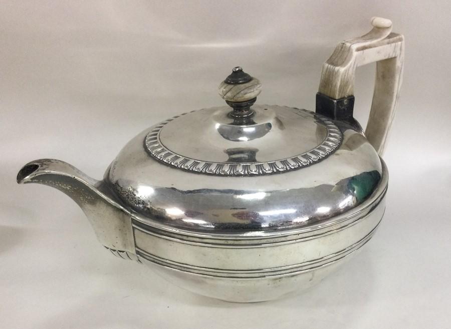 A good heavy circular Georgian silver teapot. Lond
