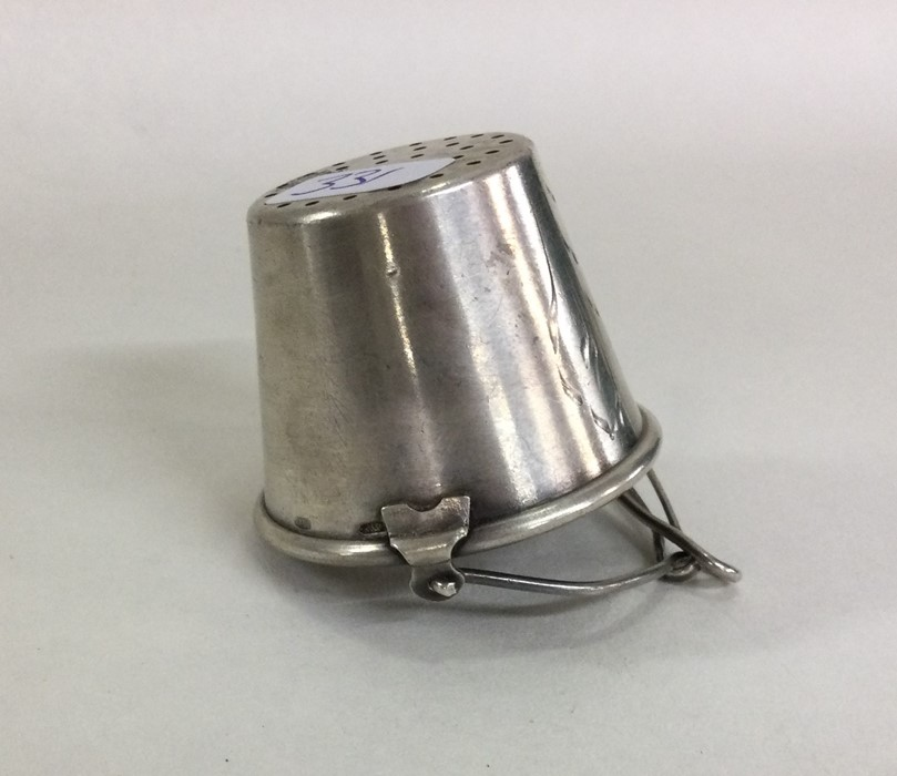 A tapering Russian silver tea strainer with gilt h - Image 2 of 2