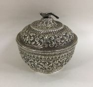 A good quality chased Indian silver bowl and cover