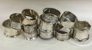 A large selection of silver napkin rings. Various
