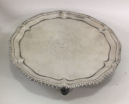 A George III circular silver salver with crested f