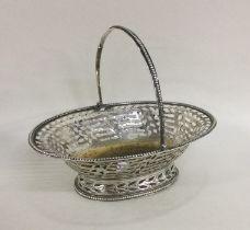 A George III pierced silver basket on pedestal bas