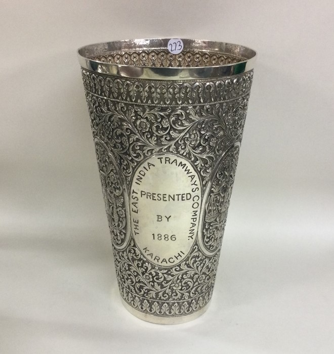 A large chased Indian silver tapering vase decorat