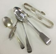 Two silver dessert spoons together with sugar tong
