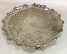 A heavy George III silver salver with engraved dec