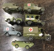 CORGI: A diecast toy army truck together with othe