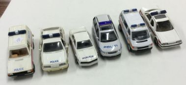 CORGI: A toy Ford Escort police van together with