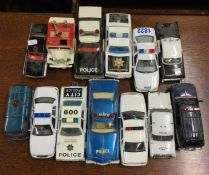 CORGI: A toy 'Oldsmobile' police car together with