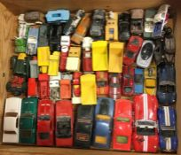 A selection of HOTWHEELS and other toy race cars.