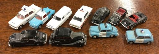 OXFORD: A group of eleven toy police cars. (11)