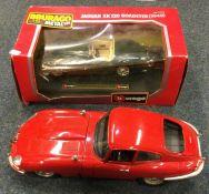 An unboxed Bburago diecast model of a Jaguar 'E' (
