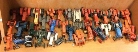 A collection of vintage toy tractors of varying ma