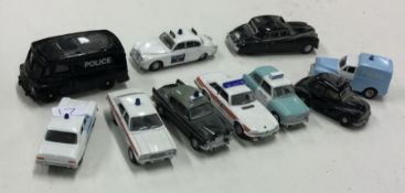 OXFORD: A group of ten toy police cars. (10)