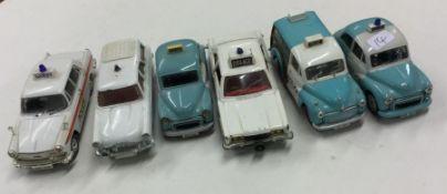 CORGI: A toy Morris Minor police car together with