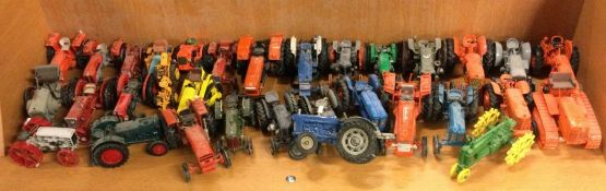 A collection of vintage tractors of varying makers