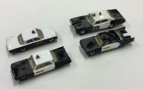 DINKY: A toy Ford Fairlane Police car together wit