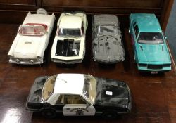 GMP: A diecast toy police car together with four o