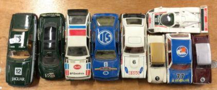Nine CORGI and other similar race cars of varying