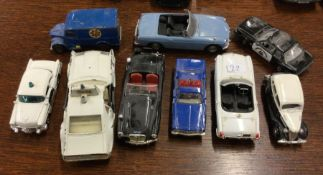 VANGUARDS: A toy police car together with eight ot