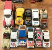 A collection of CORGI and other toy race cars.