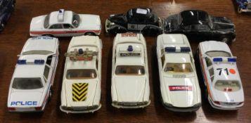 CORGI: A toy Jaguar XJ police car together with se