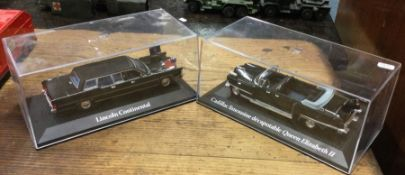A cased toy 'Cadillac' together with one other.