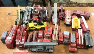 A collection of HOTWHEELS and OXFORD toy fire engi