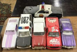A MOTORMAX toy Mustang together with other cars of