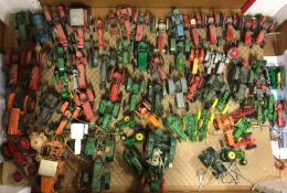 A large box containing toy tractors of varying mak