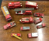 A selection of various toy fire trucks to include