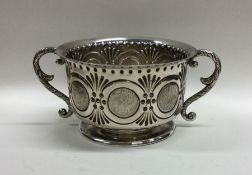 A good quality chased silver two handled sugar bow