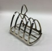 A heavy silver five bar toast rack on bracket feet