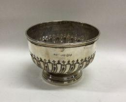 An Edwardian silver half fluted cream bowl. London.