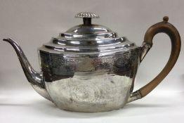 A good Georgian bright cut silver teapot. London.