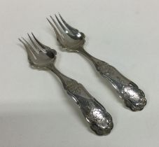 A pair of attractive Dutch silver forks with scrol