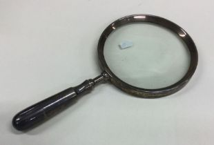 An unusual silver mounted magnifying glass with ta