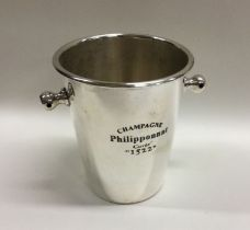 An unusual silver plated beer bottle cooler of tap