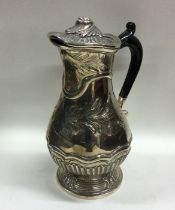 A heavy Georgian silver baluster shaped ewer with