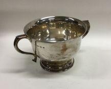 A heavy silver two handled sugar bowl. Sheffield.