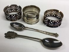 A pair of silver pierced napkin rings together wit